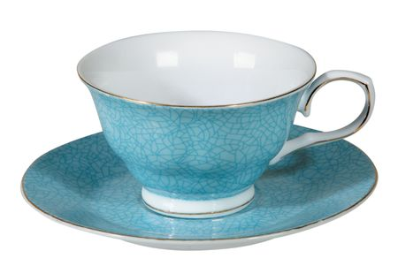 Tea cup and saucer on white background