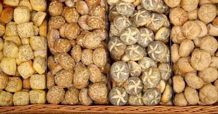 fresh baked rolls in a basket close up