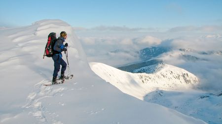 mountaineer enjoying view from the top of the winter mountains Stock Photo - 2953961