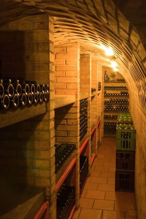 wine cellar with stacked bottles photo