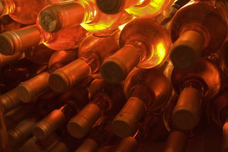stacked bottles of rose wine photo