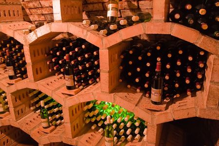 mustiness: stacked bottles inside a wine cellar Stock Photo