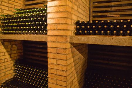 stacks of wine bottles lying on the shelves photo