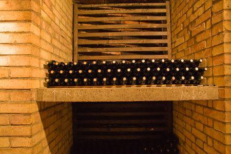 stacked wine bottles on the shelf Stock Photo - 2846893