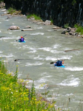 two kayakers in alpine wildwater photo