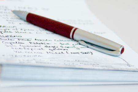 a close-up of notebook and a pen on it photo