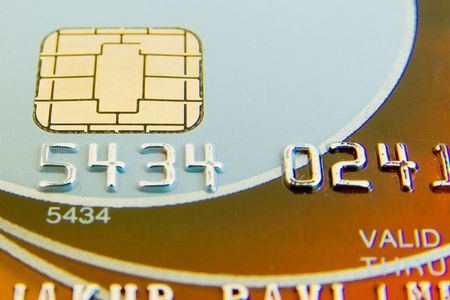 a close-up of credit card with chip and numbers photo