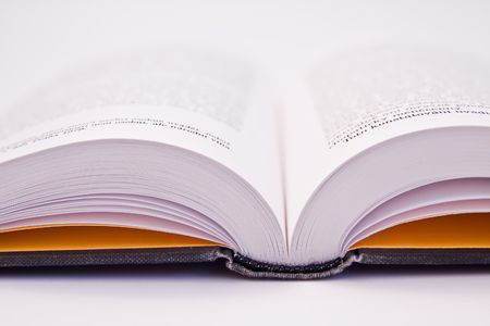 a close-up of open book on white background photo