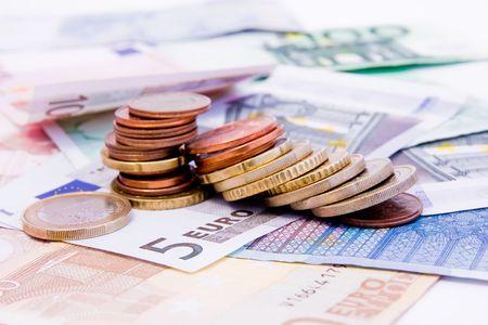 euro banknotes: Euro banknotes with various coins