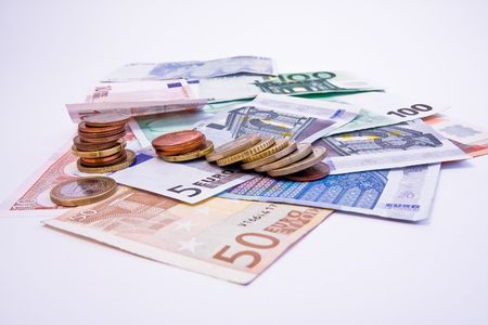 Euro banknotes with various coins Stock Photo - 2925731