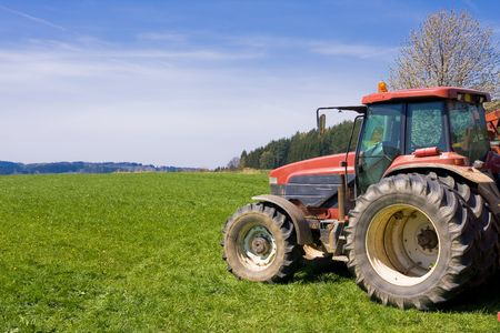 tractor on a meadow photo