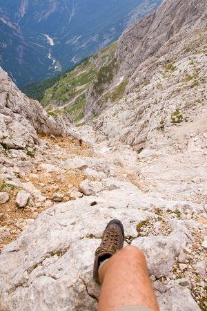 climbing on ferrata in julian alps, slovenia photo