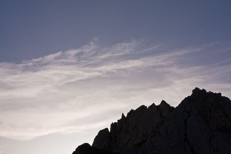 silhouette of the mountains at the dusk photo
