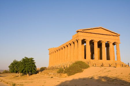 greek temple at the sunset photo