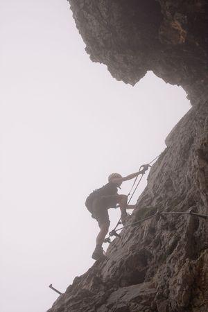 female climbing ferrata in julian alps, slovenia photo