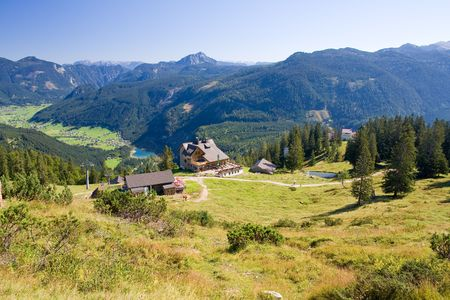 mountainside: a view from the top of the alpine peak in the summertime