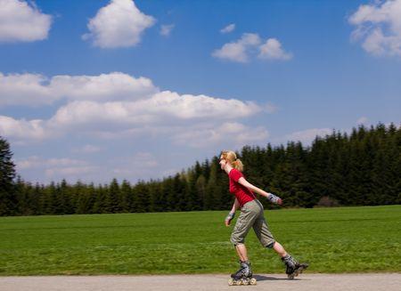 roller blade: young female on roller skates