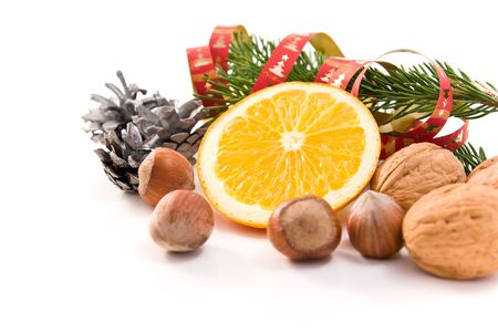 christmas decoration with orange and nuts photo