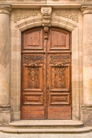 wood carving: a closeup of old wooden door