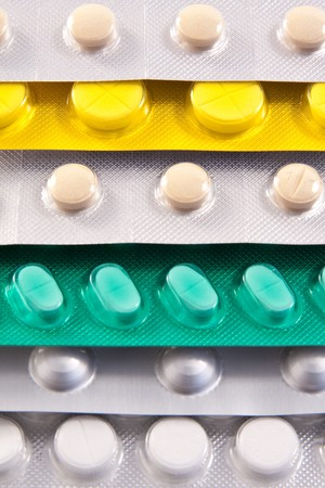 packs of medical pills and tablets photo