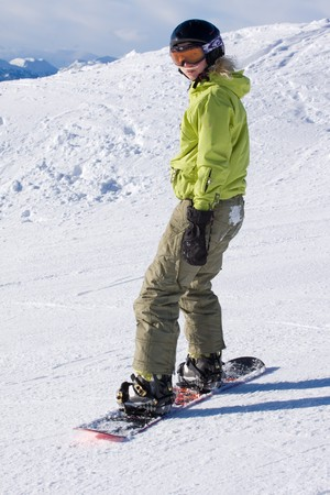 female snowboarder in snowy mountains Stock Photo - 4187160