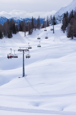 chairlift: a ski chairlift in alpine resort Stock Photo