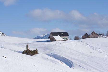 wintersport: a mountain hut in fresh powder snow