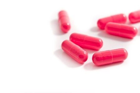 bunch of capsules on white background photo