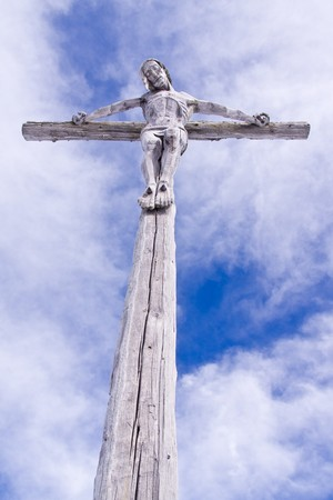 golgotha: holy cross with crucified Jesus Christ