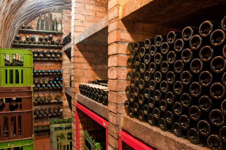 stacked up wine bottles in the cellar Stock Photo - 4654930