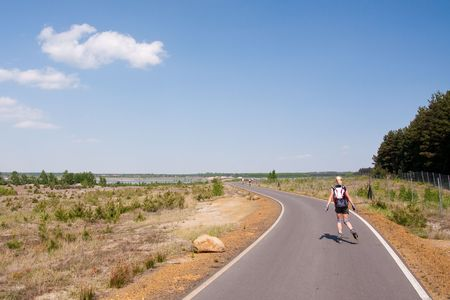 female rollerskating on new paved road photo