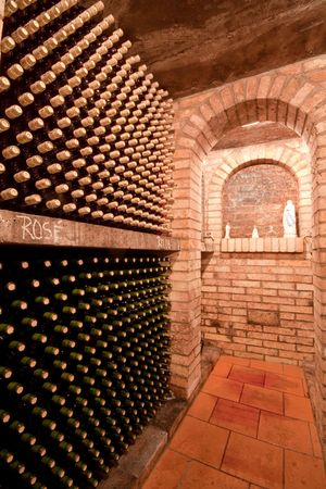 maturing: stacked up wine bottles in the cellar