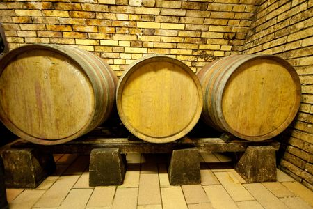 wine barrels in old wine cave photo