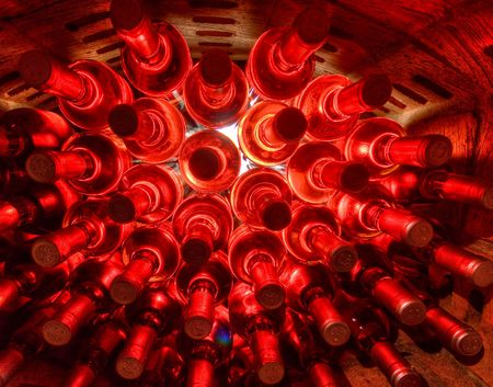 bordeaux: stacked up wine bottles in the cellar