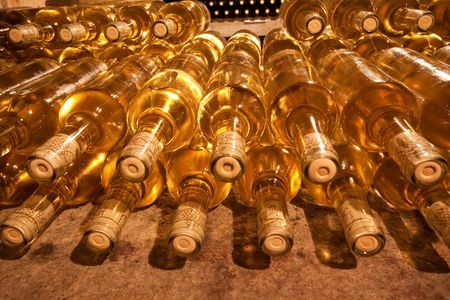 stacked up wine bottles in the cellar photo