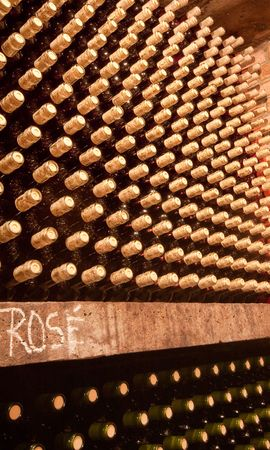 mustiness: stacked up wine bottles in the cellar