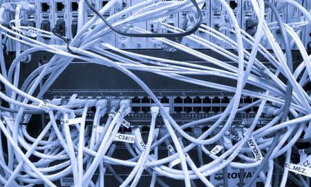 Fiber cables connected to servers in a datacenter Stock Photo - 5491444