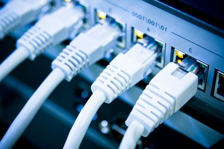 network switch: network cables RJ45 connected to a switch Stock Photo
