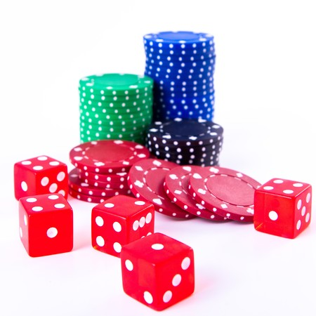 poker chips and dice on white background photo