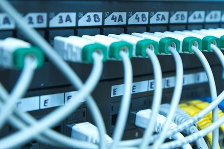 landlines: ethernet cables maze connected to switch Stock Photo