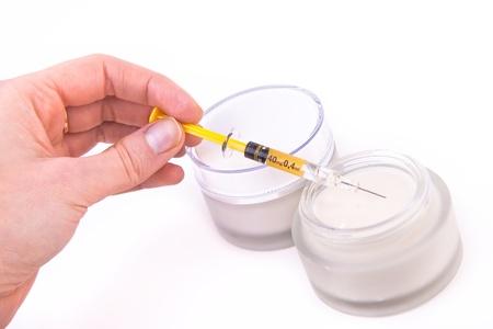 revitalizing: rejuvenating botox cream with syringe isolated