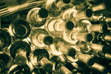 stacked up wine bottles in the wine cave photo