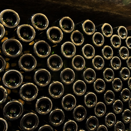 stacked up: stacked up wine bottles in the cellar