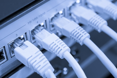 dsl: network cables RJ45 connected to a switch Stock Photo