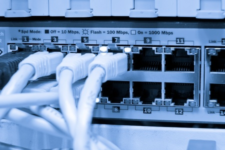bps: ethernet cables maze connected to switch Stock Photo
