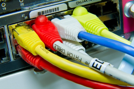 ethernet cables maze connected to switch Stock Photo