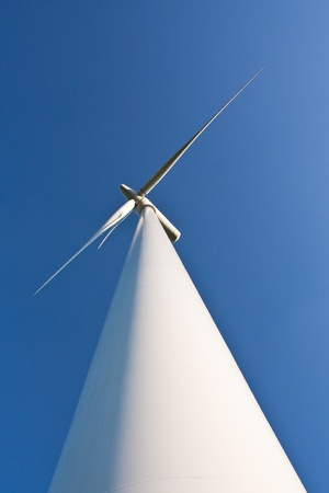 close-up of a windmill on blue sky photo