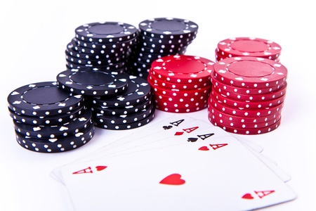 playing cards and poker chips on white background photo