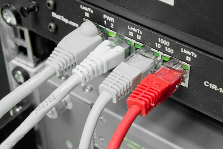ethernet cables connected to switch Stock Photo