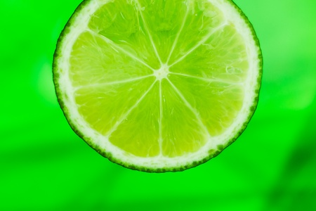 slice of lime in the water Stock Photo